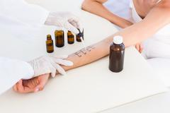 Doctor doing skin prick test at her patient Stock Photos