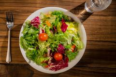 Stock Photo of Healthy salad and glass of water