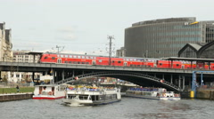 Ferry boats and red train in Berlin Stock Footage