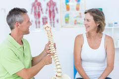 Doctor showing anatomical spine Stock Photos