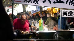 Wok with boiling soup on night market stand, street restaurant Stock Footage