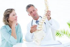 Doctor pointing anatomical spine Stock Photos