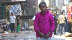 Portrait of Indian boy at a dirty street in Mumbai. Stock Footage