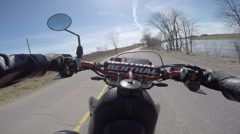 4K pov motorcycle riding along water's edge Stock Footage