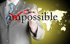 Businessman Hand turning the word Impossible into Possible with red marker - stock illustration