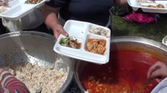 Serving chicken goulash soup and pilaf Stock Footage