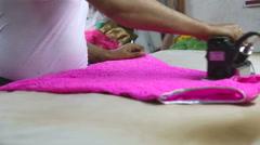 Man ironing women's clothes in Mumbai. Stock Footage
