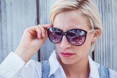 Pretty blonde woman wearing sun glasses Stock Photos