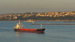 Freighter and ferry at sunset Bosporus Strait Istanbul, Turkey - 4K 0753 Stock Footage