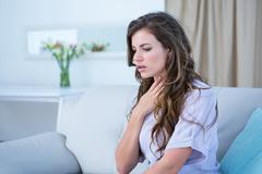 Stock Photo of Pretty woman doing asthma crisis