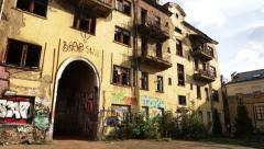 Abandoned house with graffiti in the urban ghetto. Pano shot - stock footage