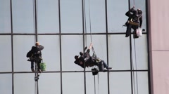Window Cleaners Rappelling from Skyscraper Stock Footage