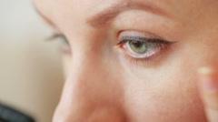 Eye make-up closeup - pencil and mascara Stock Footage