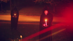 Creepy monks with candles Stock Footage