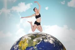 Stock Illustration of Composite image of full length of a sporty young woman jumping