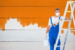 Composite image of handyman with paintbrush and can leaning on ladder at home Stock Photos