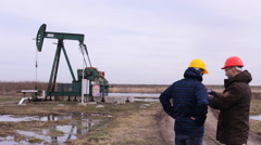 Worker and Engineer  on Industrial machine pump oil jack working  Stock Footage