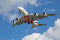 MANCHESTER, UNITED KINGDOM - APRIL 11, 2015: Airbus A380 Emirates on approach - stock photo