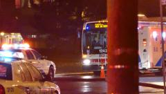 Police cruiser driving on top of fire hose line in the street at night Stock Footage
