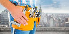 Composite image of midsection of handyman wearing tool belt Stock Photos