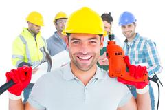 Composite image of happy repairman holding hammer and drill machine Kuvituskuvat
