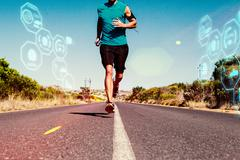 Stock Illustration of Composite image of athletic man jogging on open road