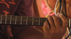 Extreme Close Up of Strumming a Guitar- PALAU Stock Footage