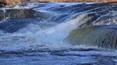 Water running between rocks Stock Footage