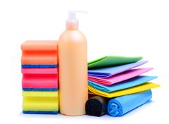 Cleaning supplies, paper napkins, gel and trash bags Stock Photos