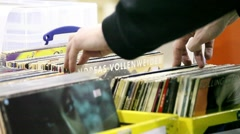 Buyers are choosing old vinyl records in the shop Stock Footage