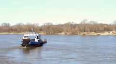 Transporting cars across the Oka river in the spring. Russia Stock Footage