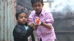 Portrait of two Indian boys pointing a laser gun. - stock footage