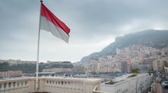 Monte Carlo - Monaco Flag over the city Stock Footage
