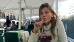 Beautiful girl drinking Sangria Stock Footage