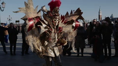 A costumed carnival goer at Venice Carnivale Stock Footage