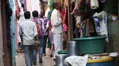 People passing through a narrow street in Mumbai. Stock Footage