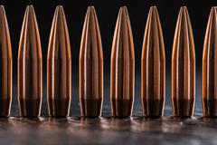 Macro shot of copper bullets that are in one row Stock Photos