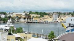 City River Road Santo Domingo cars palms Stock Footage