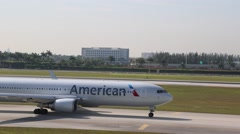 American Airlines Airplane Taxiing on Tarmac - stock footage