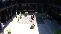 People in courtyard of Former Residence of Li Hongzhang, Hefei, China Stock Footage