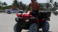Soft Focus of ATV and Rider on Beach - stock footage