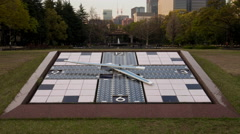 Time lapse of clock at Hibiya park in Tokyo. Camera tilts and pans up Stock Footage