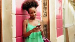 African American Girl Shopping And Text Messaging On Phone - stock footage