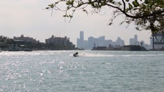 Waverunners Enjoying the Ride in Foreground of Highrise Condos in Miami Stock Footage
