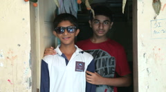 Portrait of two Indian teenage boys in front of the house entrance. Stock Footage