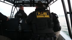 Police/Federal Agents in Moving Boat Stock Footage