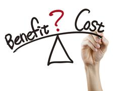 Balance between benefit and cost written by hand Stock Photos