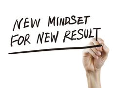 New mindset for new results words written by hand Stock Photos