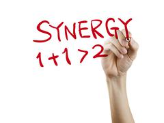 Synergy word written by hand Stock Photos