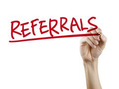 Referrals word written by hand Stock Photos